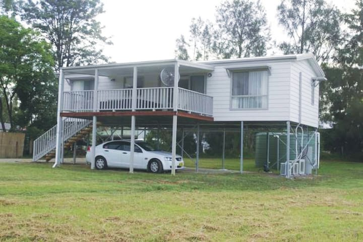 Elevated purpose-built 2 bedroom cottage with a queen room with spa ensuite and shower over. There is also a double bedroom and a main bathroom with a double shower. The centre of the house is an open plan kitchen living dining room which opens out to the large undercover verandah to sit and enjoy the rural vista.