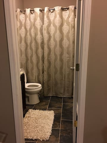 Bathroom is adjacent from bedroom and is shared.