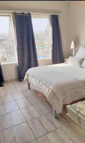 Third bedroom (master bedroom), with built in cupboards, double bed and on-suite bathroom with toilet, basin and shower.