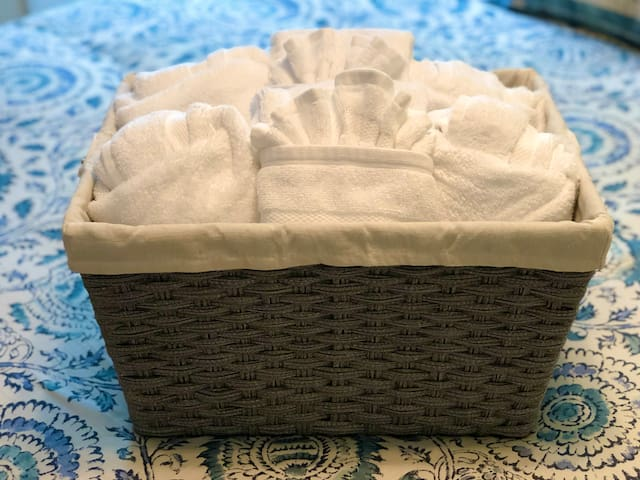 Basket with plenty of 100% cotton, fluffy towels and wash cloths.
