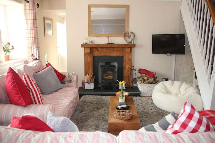 Cwtch up in the cosy living room with woodburning stove