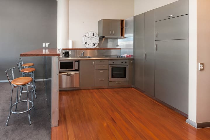 with fully equipped kitchen