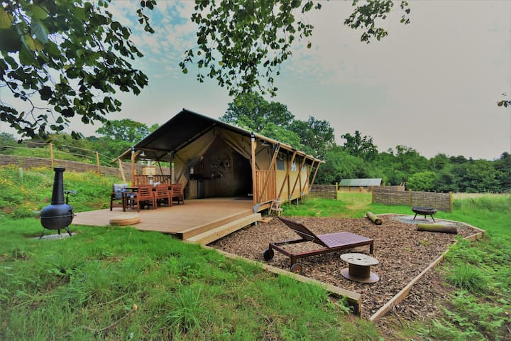 Luxury glamping tent with wood burning stove