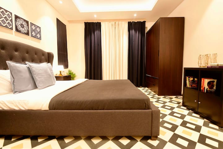 Plentiful Closet Space | Ambient Lighting | 2 Bedroom Suite | Swimming Pool | Housekeeping Services