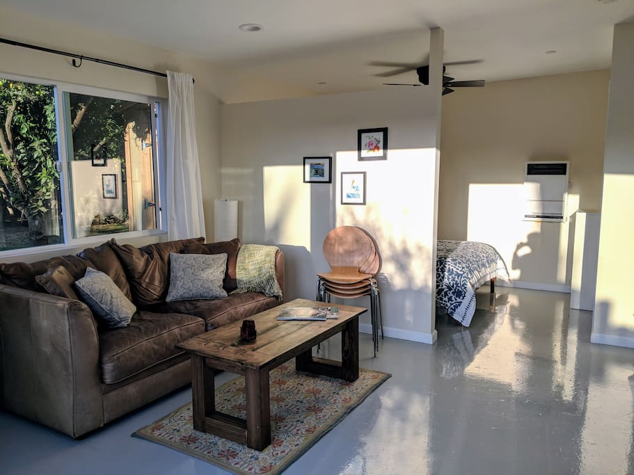 Sitting area shows pullout sofa bed and connection to sleeping nook