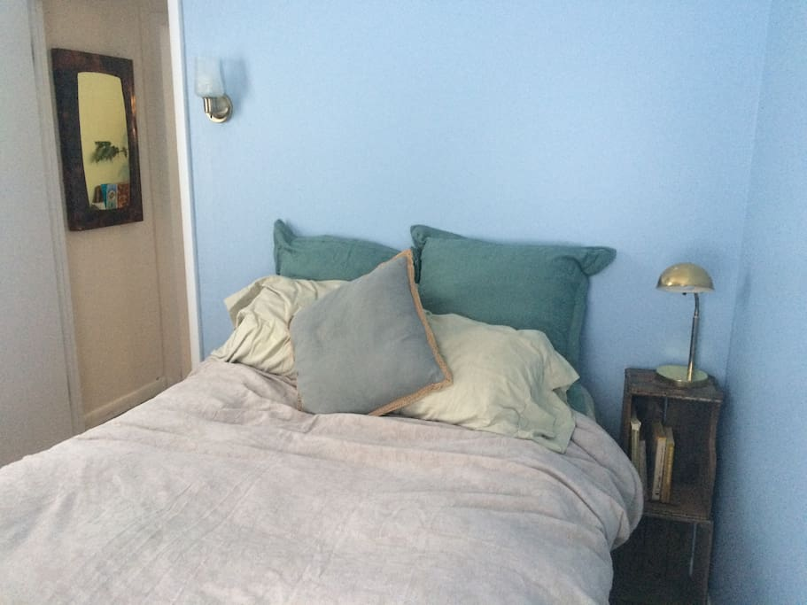 We call it the Blue Room. Nightside table with light, morning sunlight, lots of pillows and a comfy bed. Home for your stay!