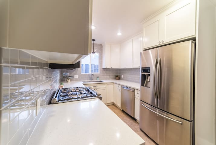 sleek stainless steel high end appliances and 5 burner gas range!