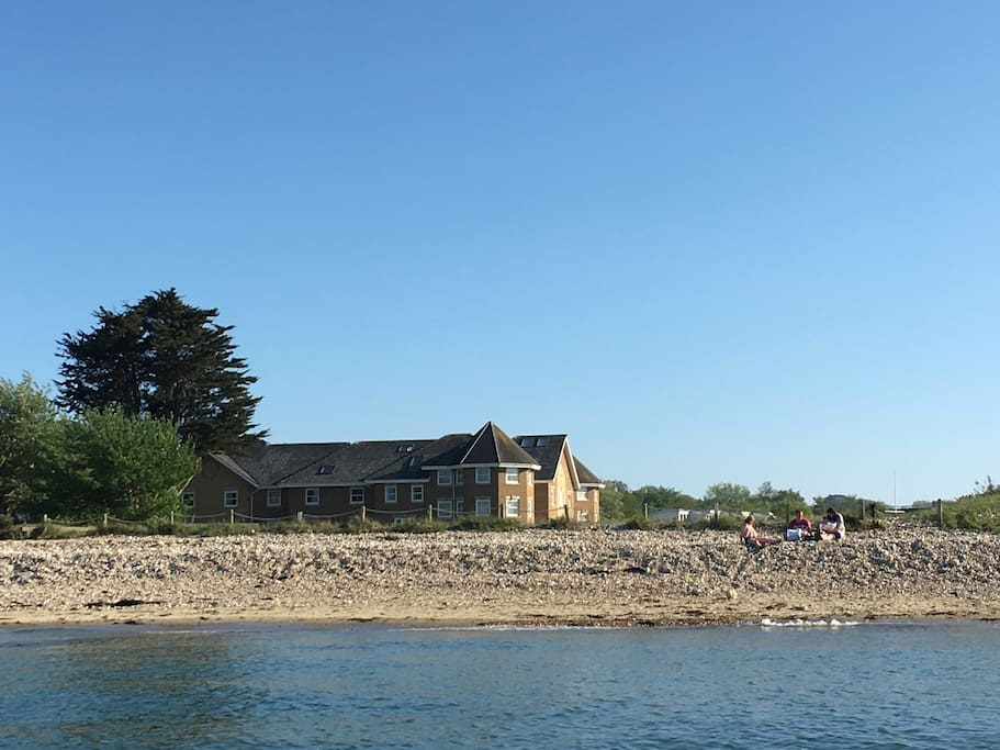 View of Solent Landing from the 'sea' side - the line of posts marks the end of the garden, truly by the sea!