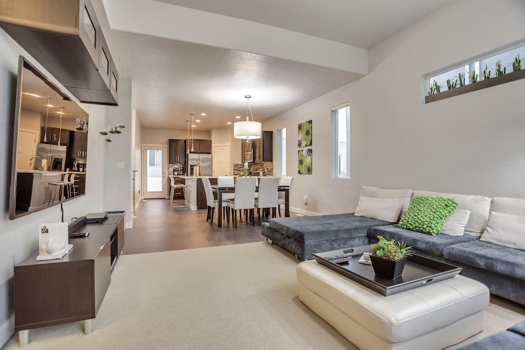 Entertain bathed in natural light with the  open concept great room and huge windows. You will find the kitchen stocked with everything you need to be a chef for the day (you will need to procure the produce, of course).