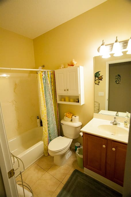 private bathroom with bath/shower and amenities