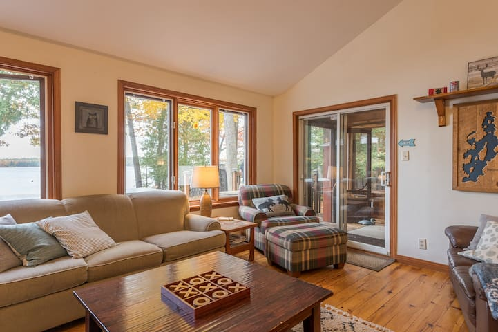 Sunken living room with gas fireplace, overlooking the lake. Sliding doors into covered porch and onto deck.