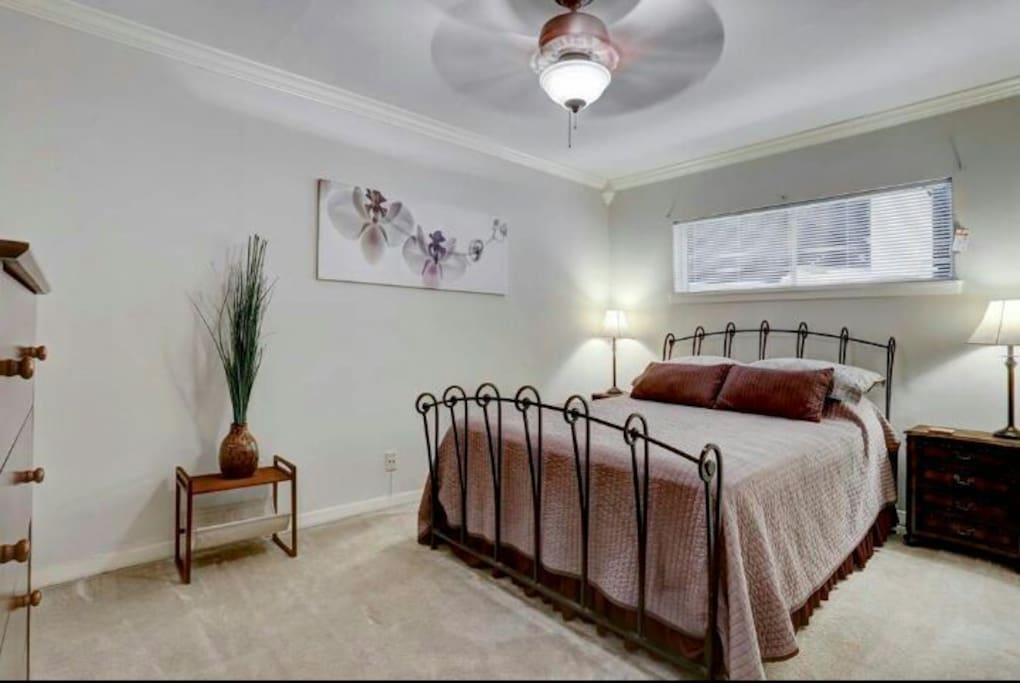 Spacious bedroom with half bathroom.