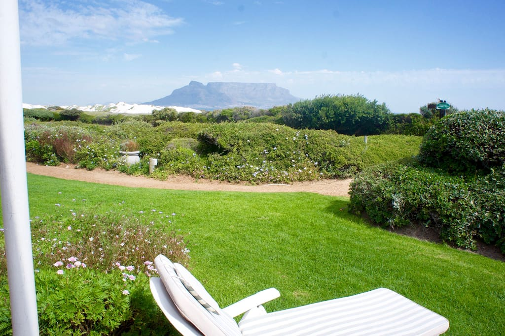 Beachfront! Table Mountain from our groundfloor garden terrace. Direct beach acces, no roads