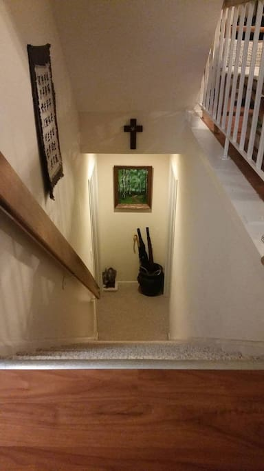stairs to the basement where you'll be staying