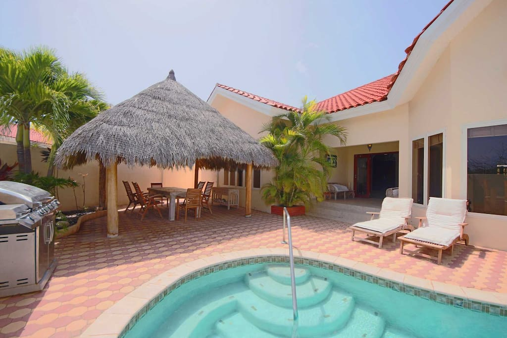 Enjoy the Aruban weather in the pool or under the palapa