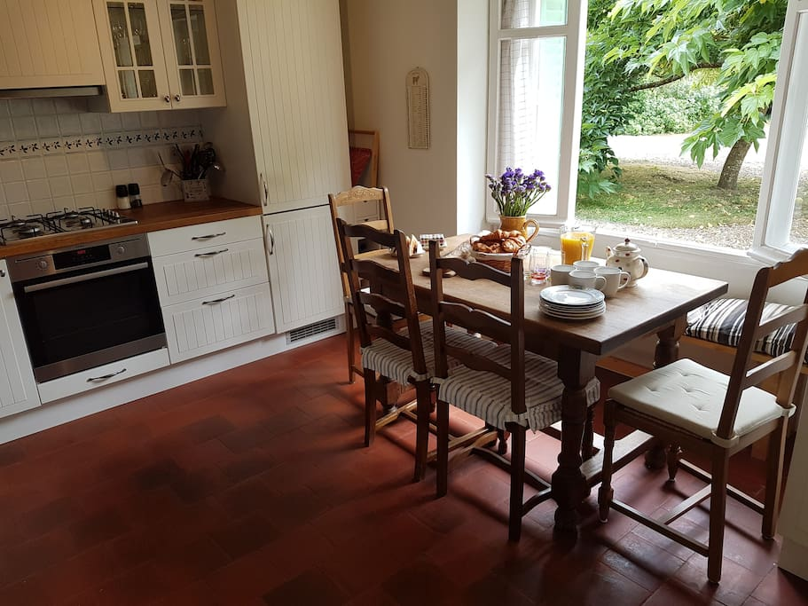The kitchen has double windows that open out onto the garden: a great spot for breakfast!