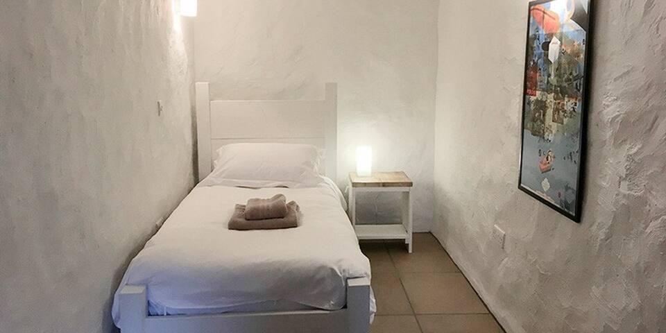 basement single bedroom