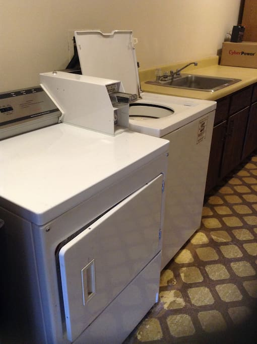 Washer and Dryer with Quarter Slots.