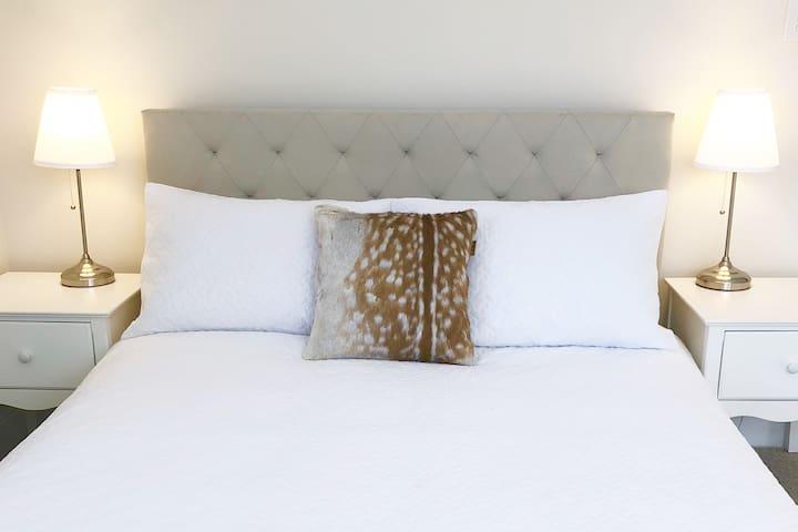Bedroom 2. Double bed, armchair, wardrobe.
