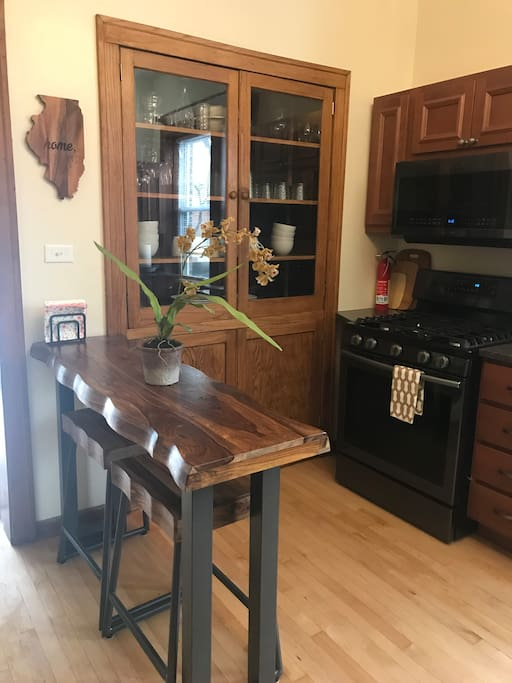 Brand new kitchen with breakfast bar and stools. Pots, pans, dishes and variety of drinkware (service for 8)