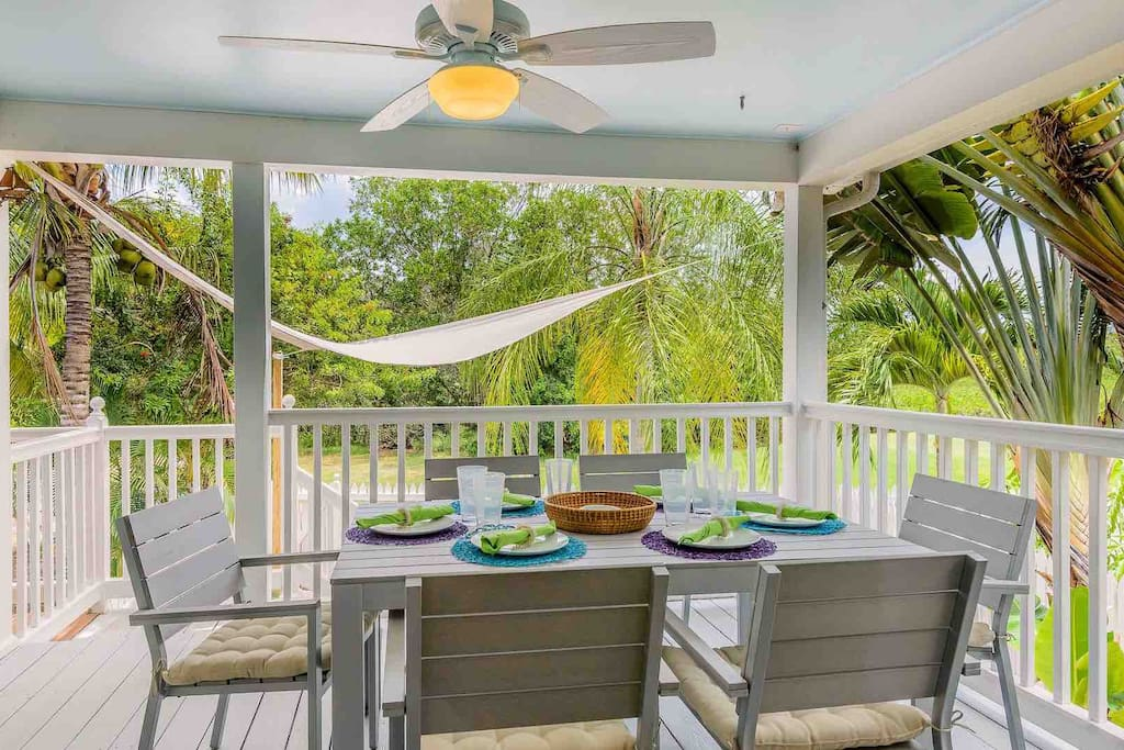 The spacious back patio has plenty of room to entertain and a view of the Golf Course greens...