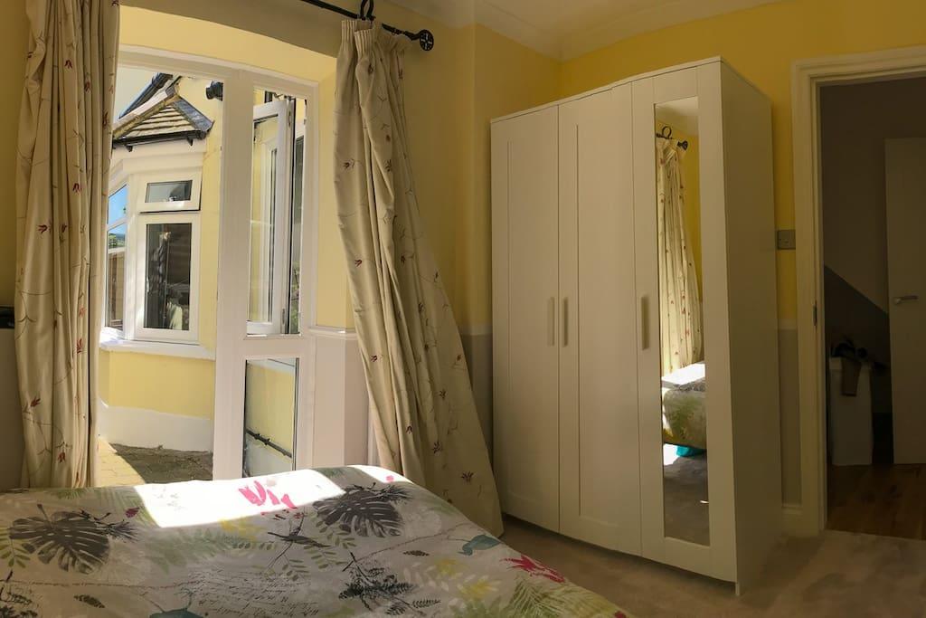 Bedroom with own door to garden