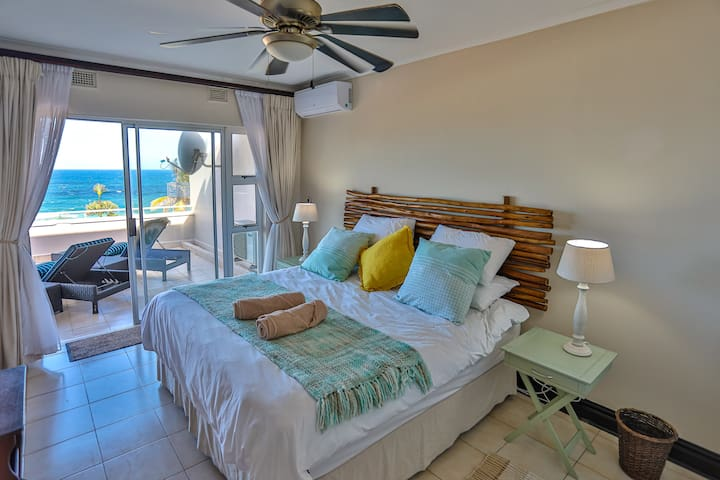Second bedroom with queen sized bed, split AC and ceiling fan. Large sliding doors lead directly onto the balcony.