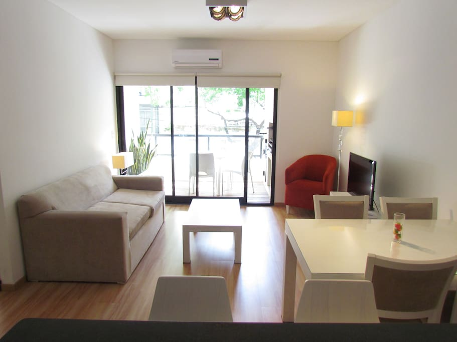 Bright and Comfortable Living room. 32¨ LCD TV with Cable. AC (hot and cold) Internet  Wi-Fi. Comfy Sofa Bed! Dining area.