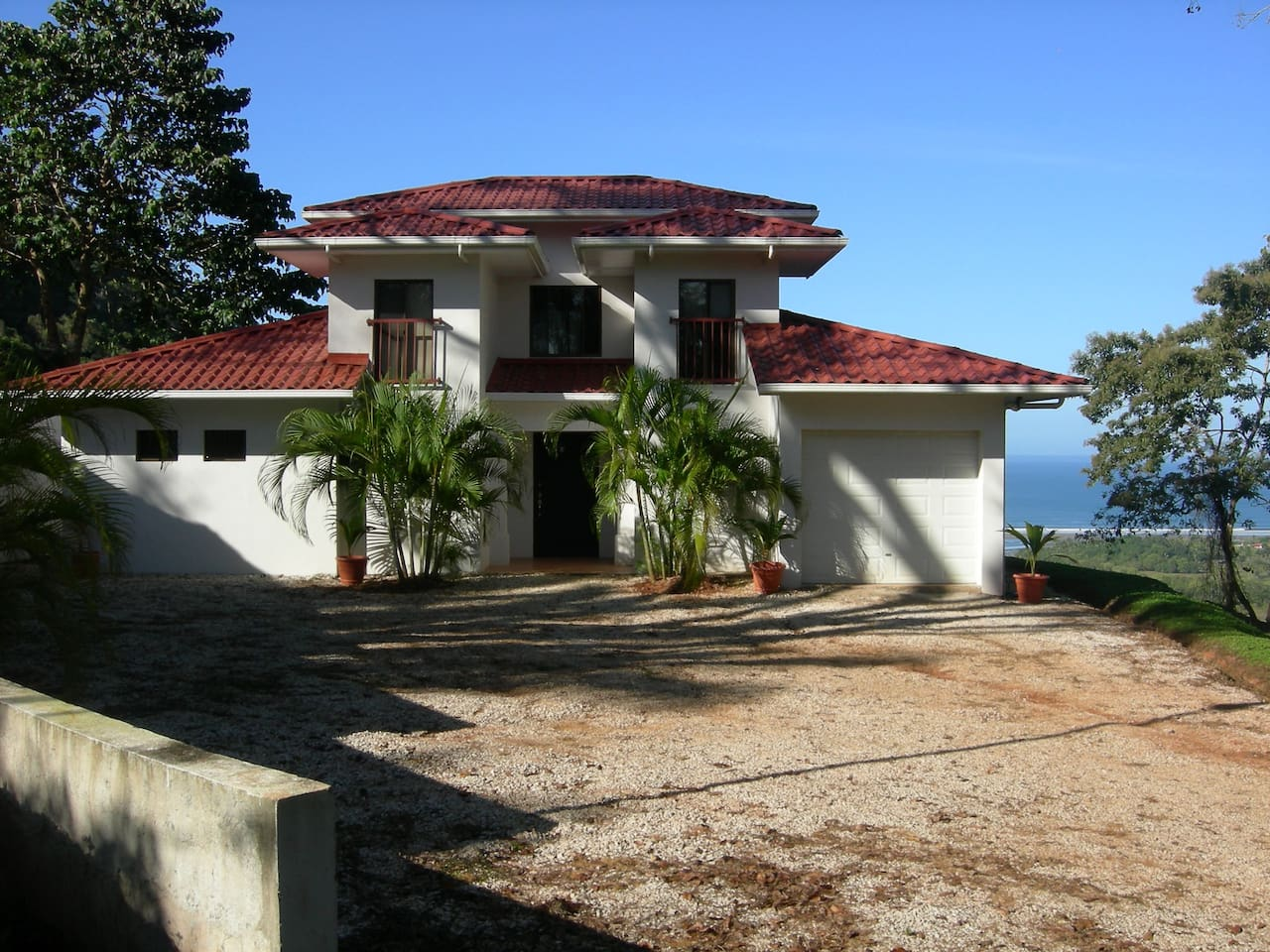 Front View of the House with the Ocean in the background