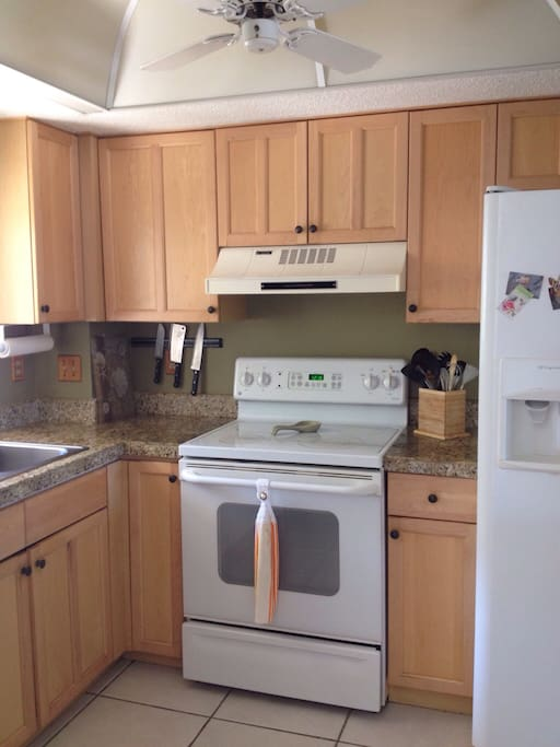 Freshly painted kitchen. Well stocked with dishes, pots, pans, utensils.