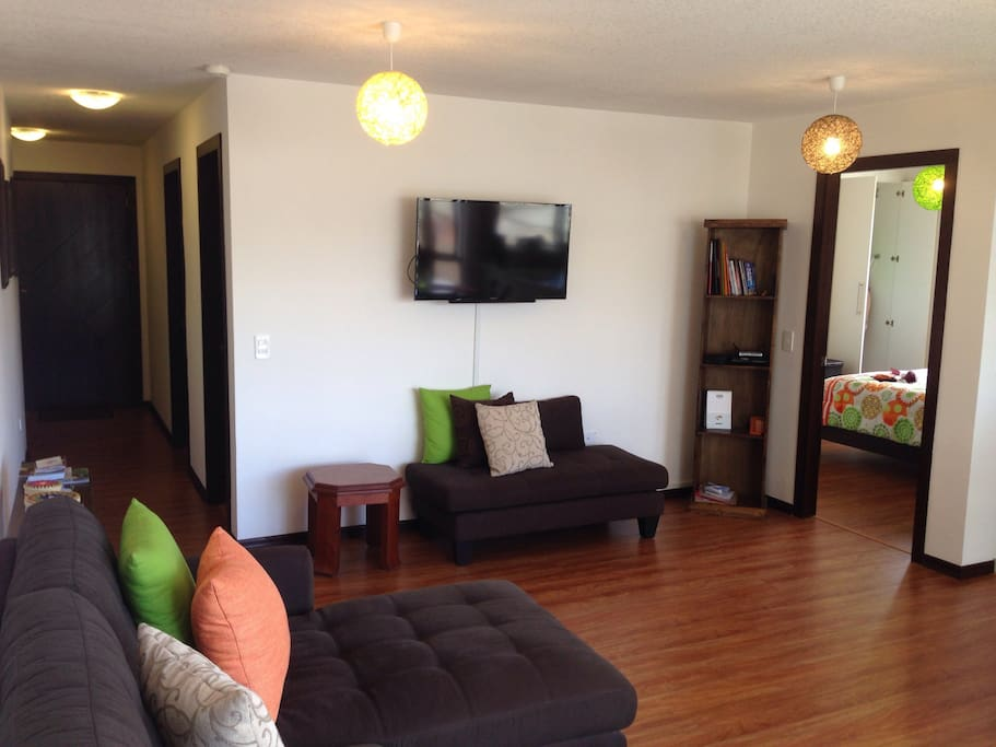Living area with wall-mounted 42 inch flat screen cable TV.