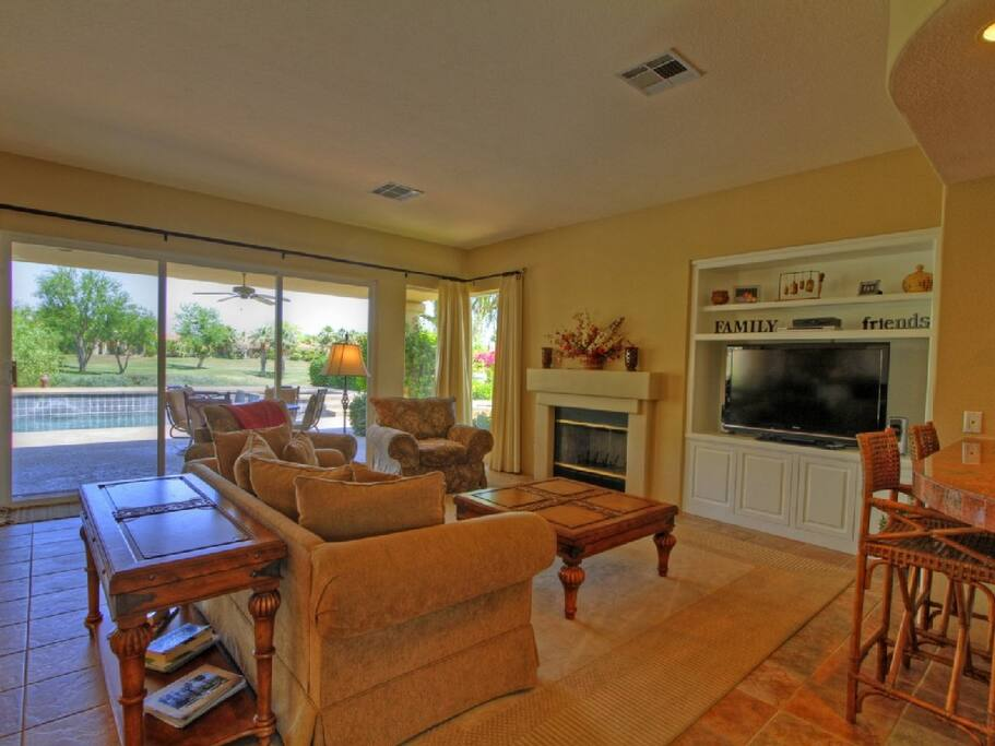 Spacious Living Room with Large Flat Screen TV, Views and a Cozy Fireplace to Enjoy!