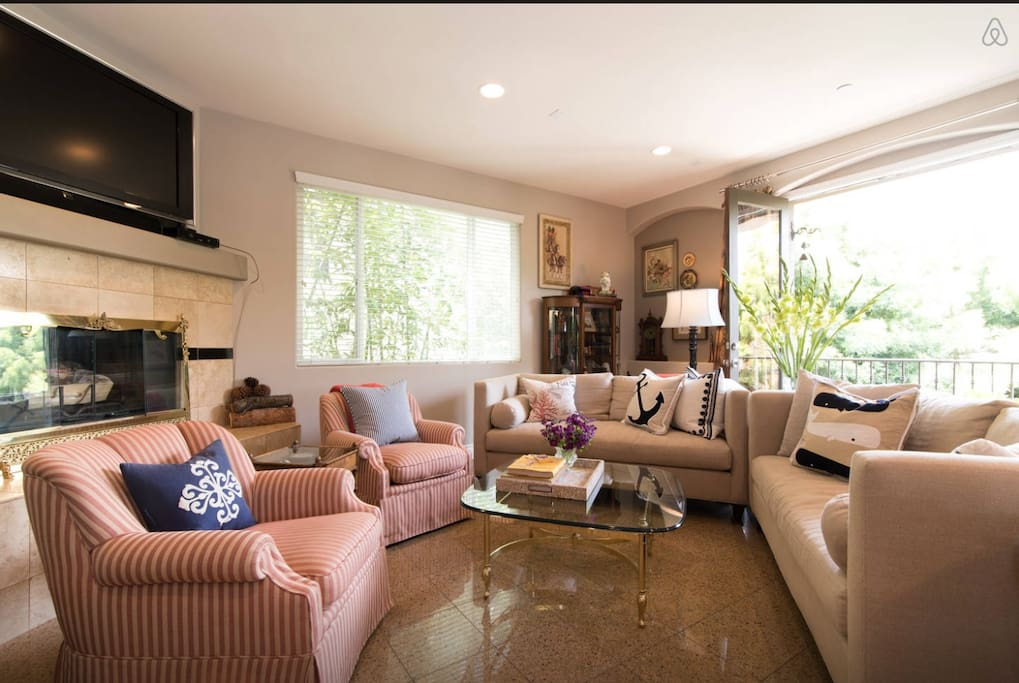 This gracious and comfortable living room boasts ample seating and a large flat screen TV.