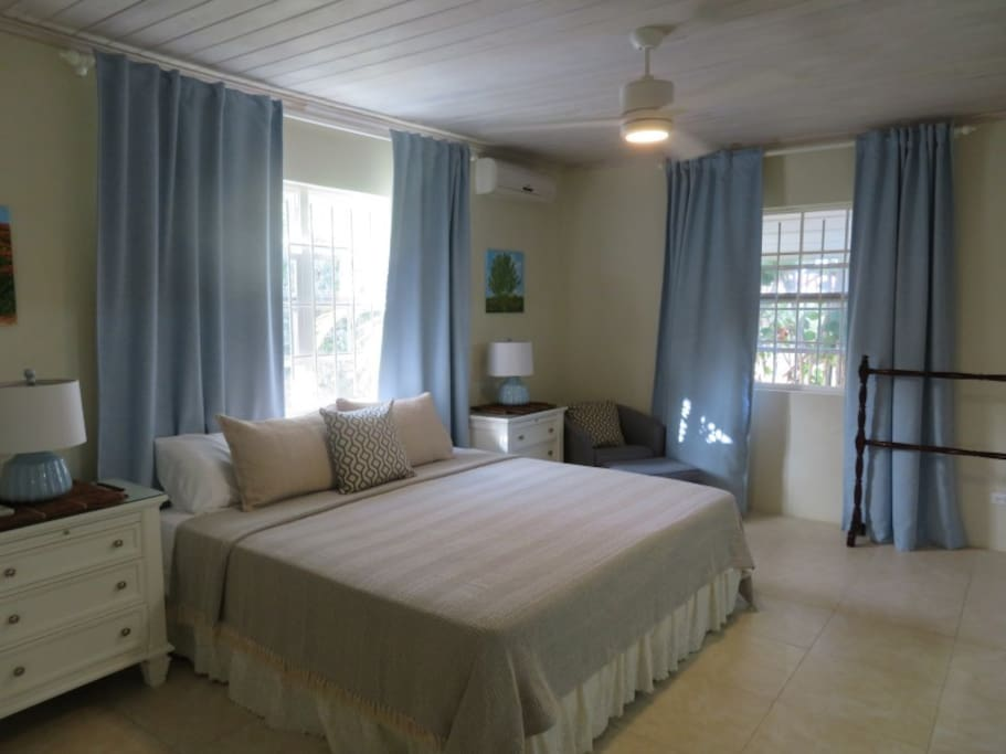 Breezy bright master bedroom with king size bed