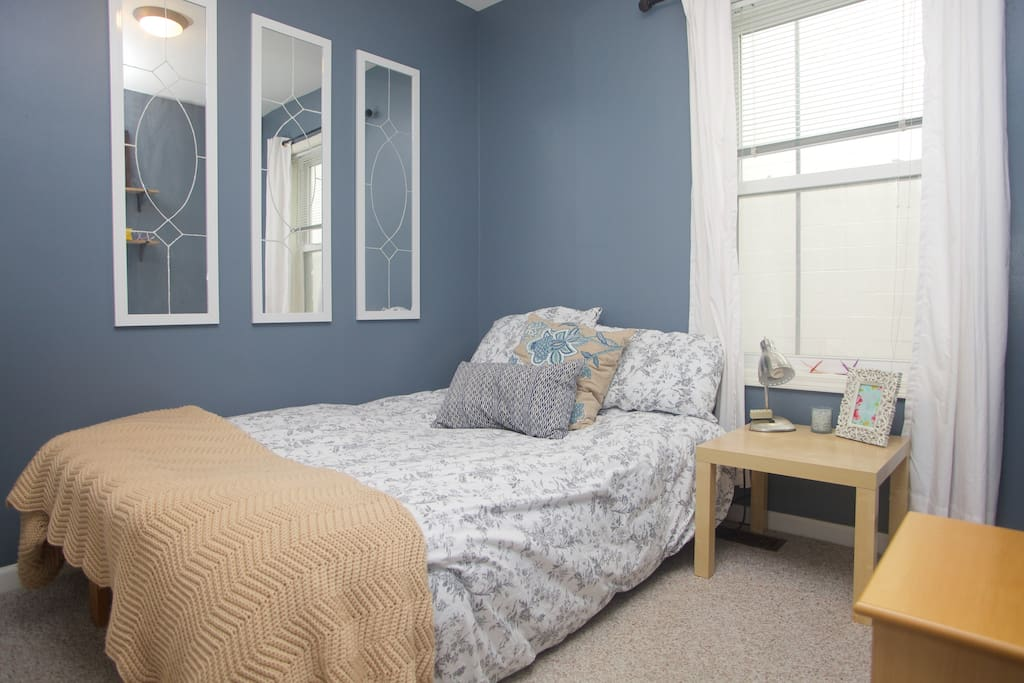 The bedroom is small but comfortable, with a full bed.