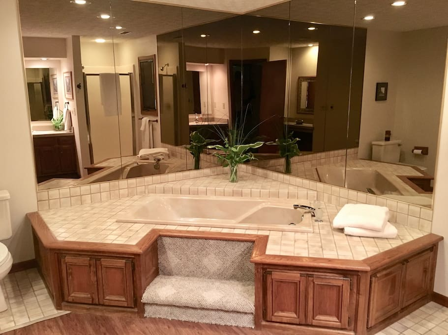Private and spacious bathroom with jacuzzi tub and fresh, crisp, white towels.