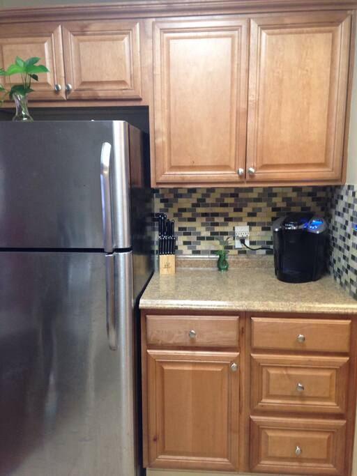 Nice  and easy to make coffee maker! Clean refrigerator and plenty of cabinet space!