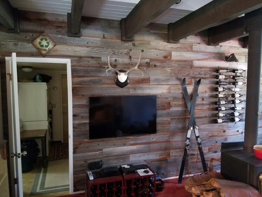 View of tv and laundry room beyond