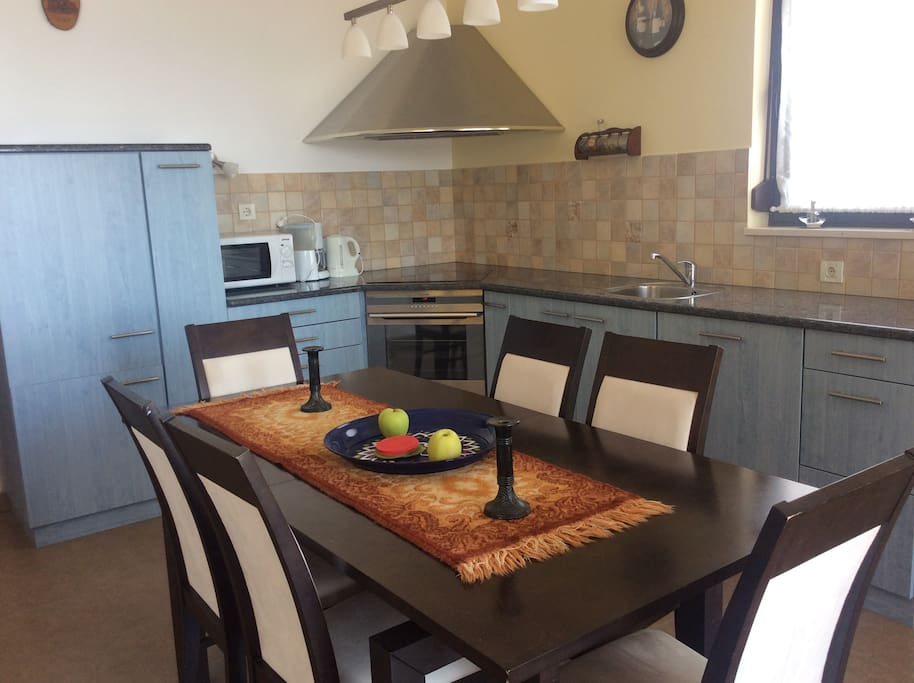 Kitchen with all appliences and a large dining table