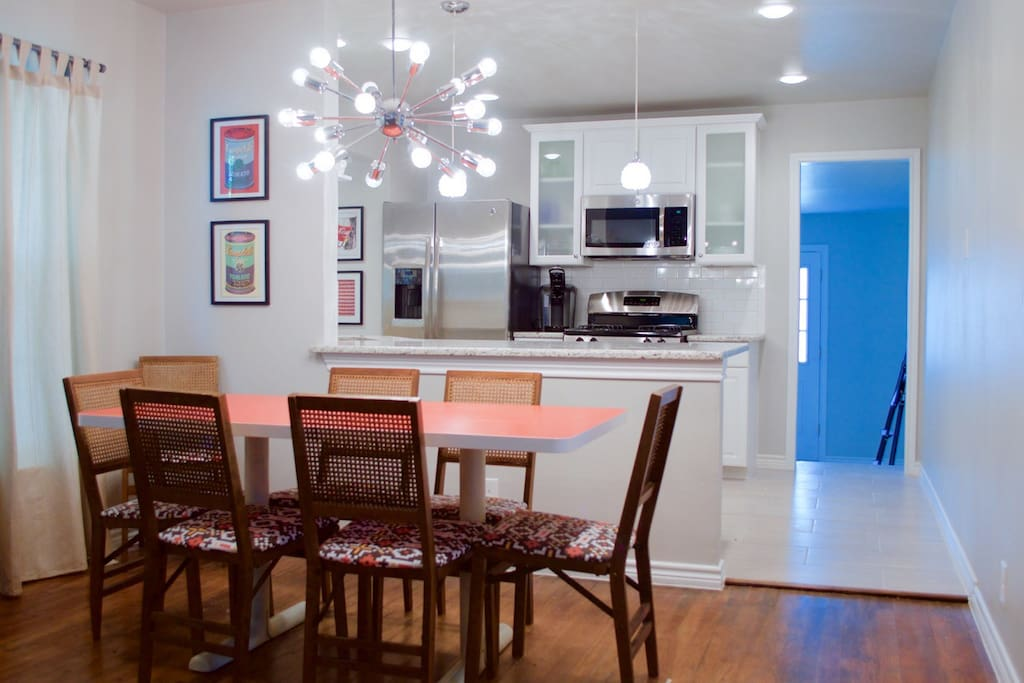 The home features an open-concept living, dining, and kitchen.