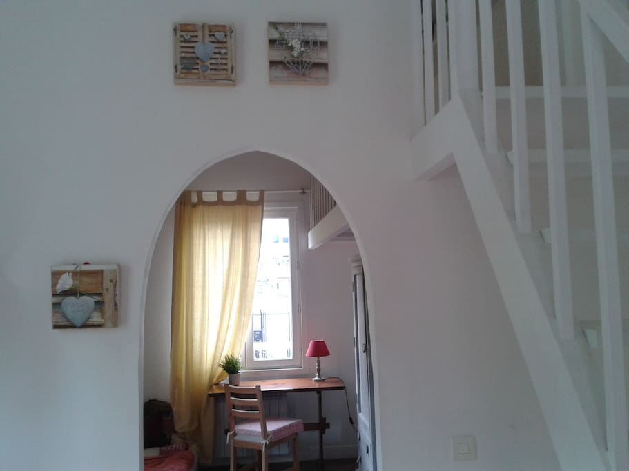 The living room and the stairs that lead to the mezzanine...