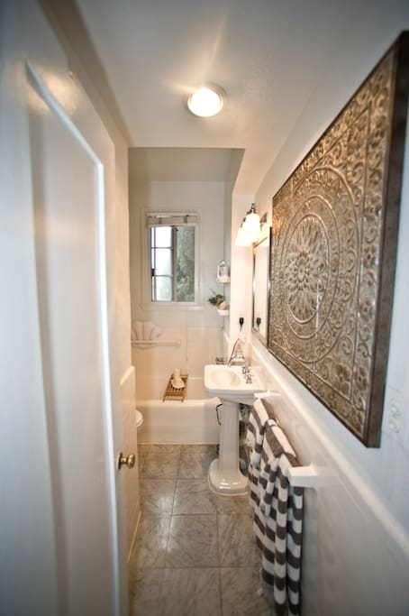 Very organized, clean bathroom. Separate shower and bath.