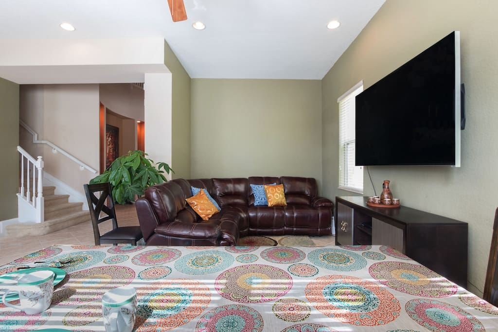 Enjoy this TV room with awesome open concept design.
