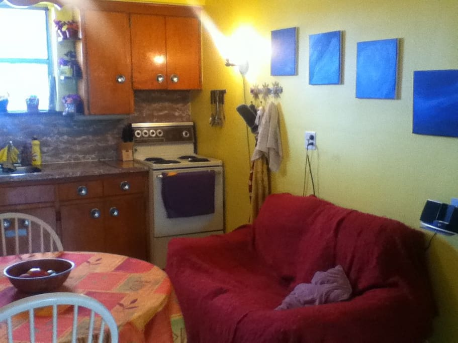 Kitchen Couch. Lots of counter space and spices for you to use!