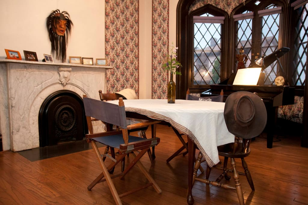 the dining room with some artifacts & grand synthesizer