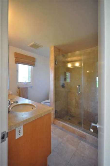 ...a private en-suite bathroom with two sinks.