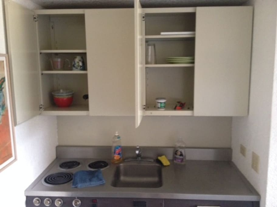 Garbage disposal, refigerator with freezer box, 3 burner stove and oven, light under coutner.