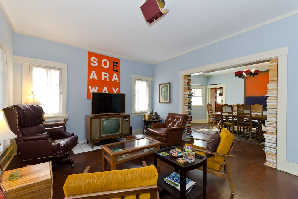 Comfy eclectic living room with plenty of musical instruments if you're feelin' strummy.