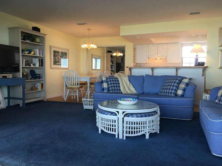 All open plan great room, dining and kitchen overlook the ocean