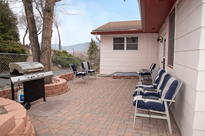 Patio with 4-burner grill and mountain views.